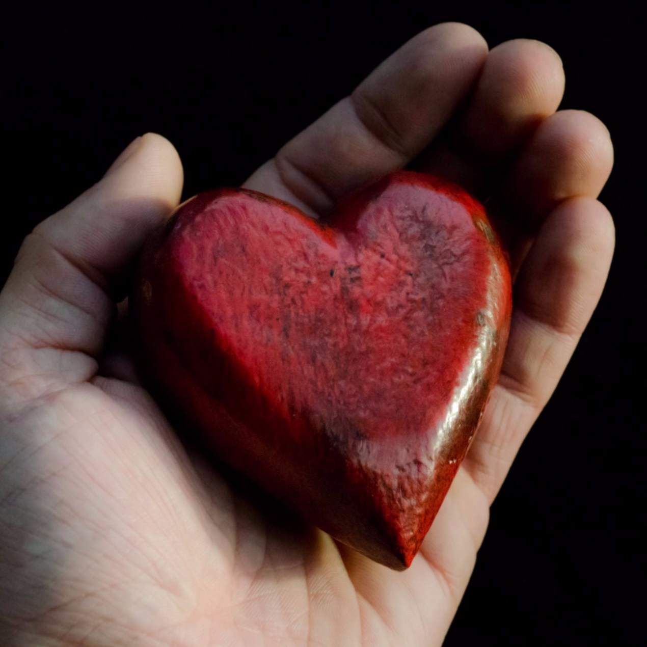 cropped-red-heart-in-hands